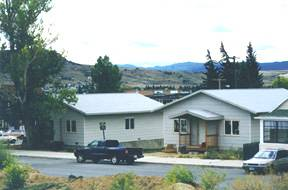 These high-performance houses were built from Network cold-climate designs in the Central Butte Neighborhood. Both are now homes for Habitat for Humanity families.